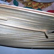 Dettaglio del riempimento degli spazi a poppa con listelli sagomati a triangolo