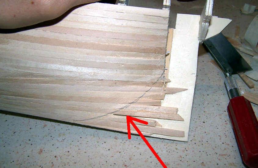 La parte bassa della poppa deve essere ridisegnata per adattarsi ad una forma diversa.