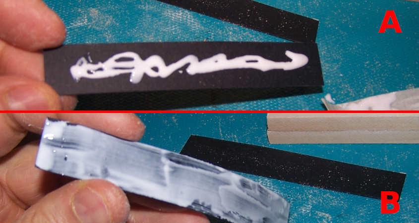 Cospargo di colla la striscia di carta nera che rappresenta la mezzeria della scialuppa della RRS Discovery.